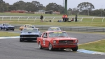 Bill Trengrove\'s 289 Mustang ahead of Stuart Barnes\' 69 Fastback