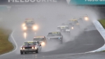 Jason Humble's Mazda waits to pounce on Andy Clempson's Mustang to take the wet race win.