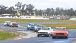 Before the heavens opened. Tessari's Monaro leads the Cup