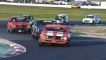 Tony Hubbard's Camaro leads Les Walmsley's Charger, the Toranas of Edwards and Girvan and the Minis of Hill and Ford